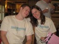 "Newlywed couple boasting ""Just Married"" shirts"