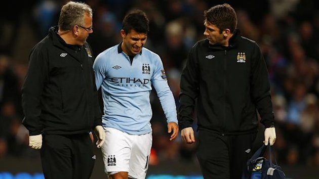Manchester City's Sergio Aguero reacts after being injured during their English Premier League match against Stoke City at The Etihad stadium in Manchester,