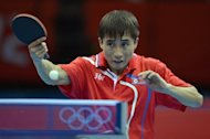 North Korea's Kim Hyok Bong returns a shot to South Korea's Ryu Seungmin during a table tennis men's team clash at the Excel centre in London. South Korea triumphed over North Korea in the first round of the men's Olympic table tennis team competition on Saturday