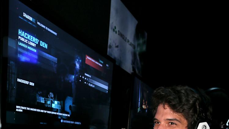 IMAGE DISTRIBUTED FOR UBISOFT - Tyler Posey is seen at the Ubisoft booth on Day 1 of E3, Tuesday, June 11, 2013 in Los Angeles. (Photo by Alexandra Wyman/Invision for Ubisoft/AP Images)