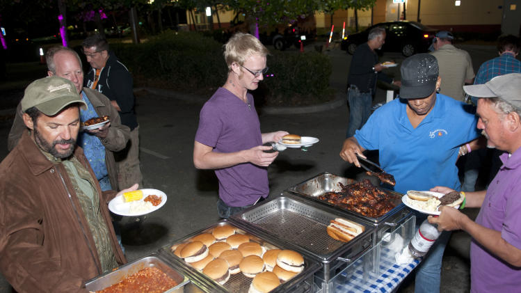 Members of the community partake in of some of the food served at the Wilton Manors Out of the Closet (OTC) Block Party & Insti-Test Launch Marking the 5th anniversary of Wilton Manors OTC in Wilton Manors, Florida on Saturday, February 2nd, 2013 at the Hagan Park/City Hall parking lot in Wilton Manors, FL. (Mitchell Zachs /AP Images for AIDS Healthcare Foundation)