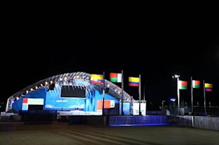 Flags stand in front of a stage ahead of the Sochi 2014 Winter Olympics at the Olympic Park, Sadly there isn't any Indian Flag