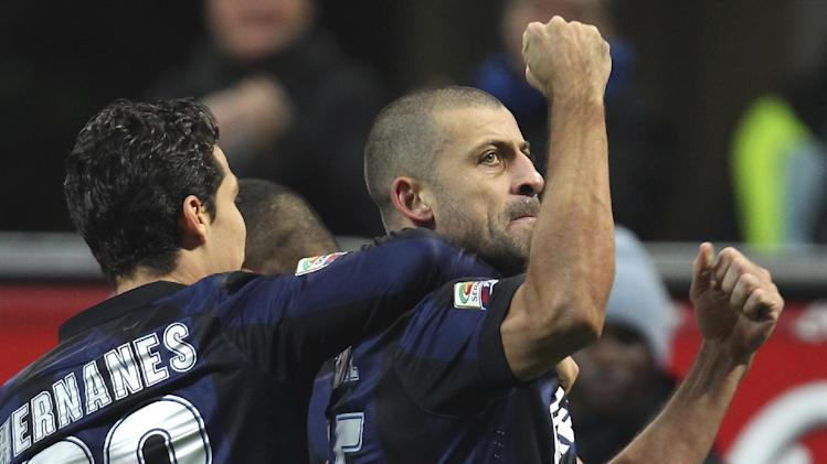 Inter Milan Argentine defender Walter Samuel, right, celebrates with his teammate Brazilian midfielder Anderson Hernanes after scoring during the Serie A soccer match between Inter Milan and Sassuolo at the San Siro stadium in Milan, Italy, Sunday, Feb. 9, 2014