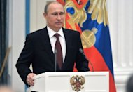 Russia's President Vladimir Putin speaks during an awards ceremony at the Kremlin in Moscow, on December 26, 2012. Russia's upper house of parliament unanimously backed Wednesday a bill barring Americans from adopting Russian children, leaving the controversial measure in the hands of Putin.