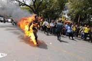 Tibetan exile Janphel Yeshi is engulfed in flames after setting himself on fire during a protest in New Delhi. Friends and neighbours of the Tibetan protester who set himself alight in New Delhi said his actions were out of character but driven by desperation felt by many in his community
