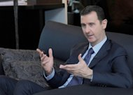 Syrian President Bashar al-Assad gives an interview to Russian newspaper Izvestia in Damascus on August 26, 2013, in a photo released by the Syrian Arab News Agency (SANA)