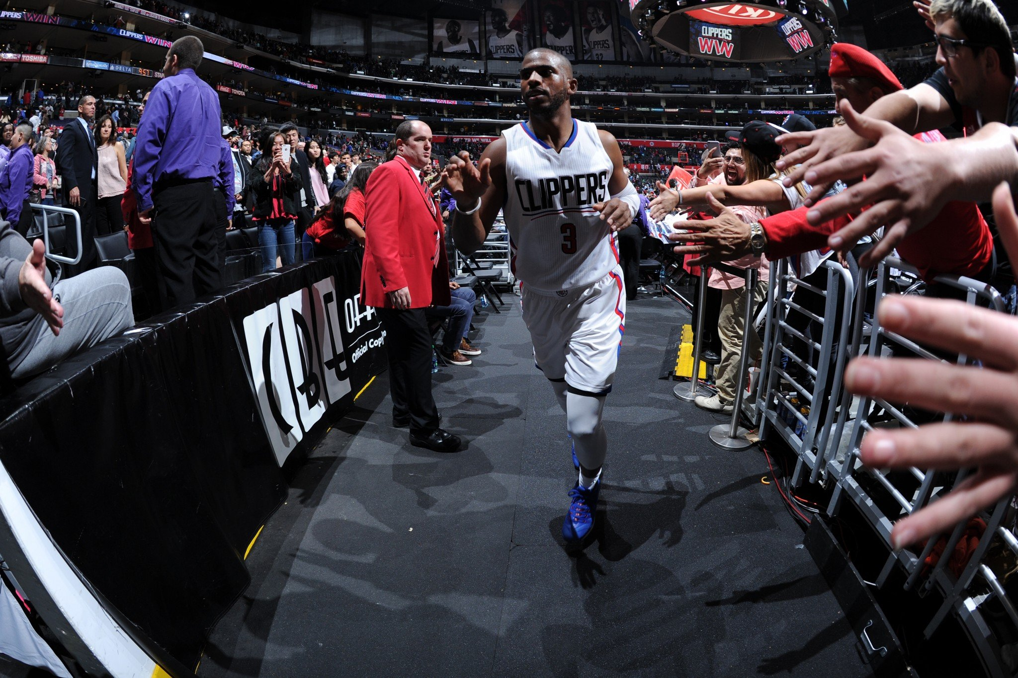 Chris Paul shakes hands with fans at Staples Center after a game against the New York Knicks on March 11, 2016. (Getty Images)