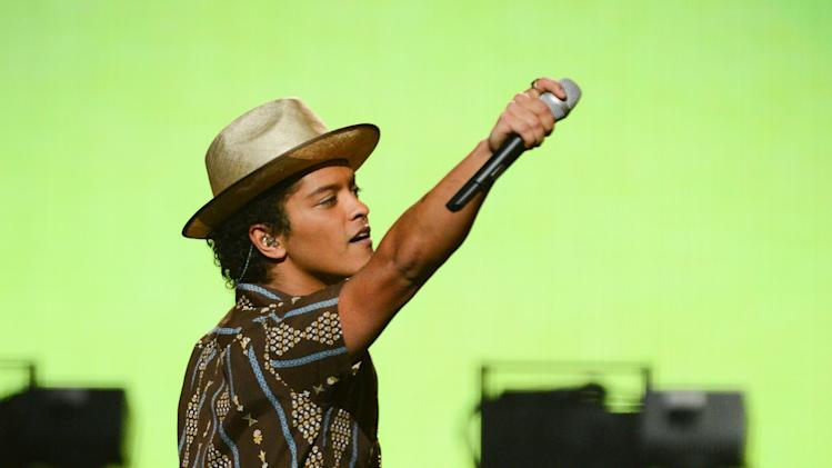 Bruno Mars performs at IHeartRadio Music Festival, day 2, Saturday, Sept. 21, 2013 in Las Vegas, NV. (Photo by Al Powers/Powers Imagery/Invision /AP)