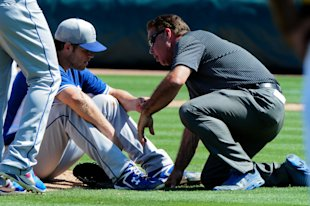 Clayton Kershaw (22) is examined after being hit by a line drive in the third inning. (USA TODAY Sports)