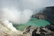 Blue Crater: A stunning green and blue lake of active volcano at Ijen Crater, located 2,380 meters above sea level, is within reach from Jember. (