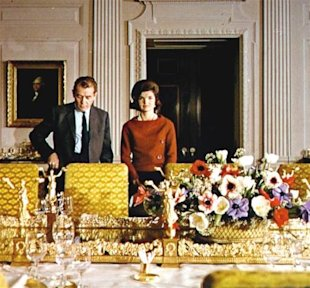 The first lady with CBS reporter Charles Collingwood in the newly restored White House in 1962.