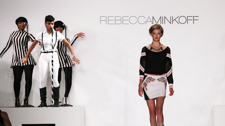 The Rebecca Minkoff Spring Summer 2014 collection is modeled as singer Janelle Monae performs, left, at New York Fashion Week on Friday, Sept. 6, 2013 in New York. (AP Photo/Lisa Tolin)