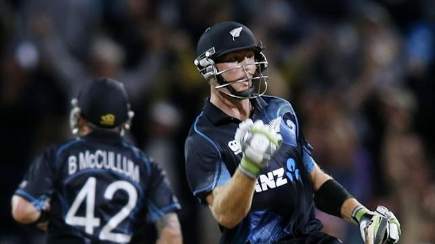 Martin Guptill of New Zealand celebrates beating England during the first cricket match of their one day international series at Seddon Park, Hamilton February 17, 2013 (Reuters)