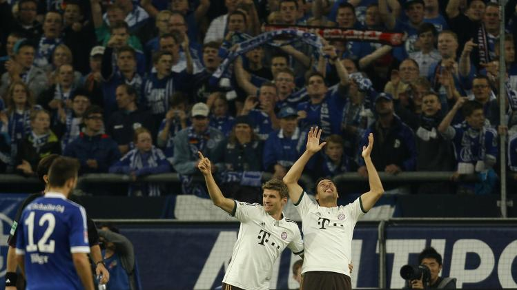Bayern Munich's Müller and Pizarro celebrate a goal against Schalke 04 during the German first division Bundesliga soccer match in Gelsenkirchen