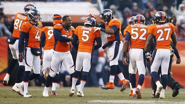 Denver Broncos kicker Matt Prater (5) celebrates with teammates after kicking a 64 yard field goal at the end of the first half against the Tennessee Titans at Sports Authority Field at Mile High
