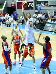 Japeth Aguilar, seen here dunking against the Meralco Bolts, will try out with the Los Angeles D-Fenders. (PBA Images)