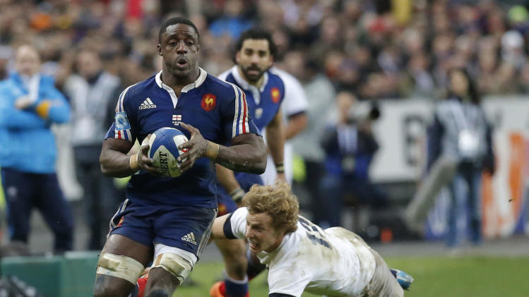 France's Yannick Nyanga, left, is tackled by England's Luther Burrell, right, during their Six Nations international rugby union match between France and England at Stade de France stadium in Saint Denis, near Paris, Saturday, Feb. 1, 2014. France won against England 26-24. (AP Photo/Michel Euler)