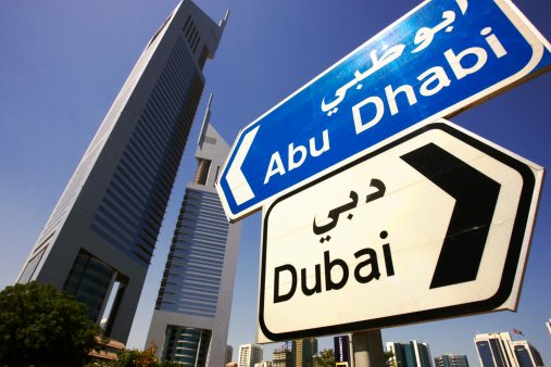 Road sign for Abu Dhabi and Dubai