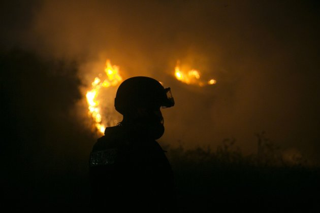 A fire-fighter works to extinguish a fire near the town of Sderot August 20, 2014. (Reuters)