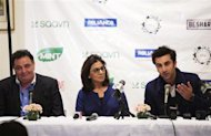 "Bollywood actors Ranbir Kapoor (R) and his parents Neetu and Rishi Kapoor (L) answer questions about what it is like to work together during a news conference discussing their new film ""Besharam"" in New York, September 23, 2013. REUTERS/Lucas Jackson"