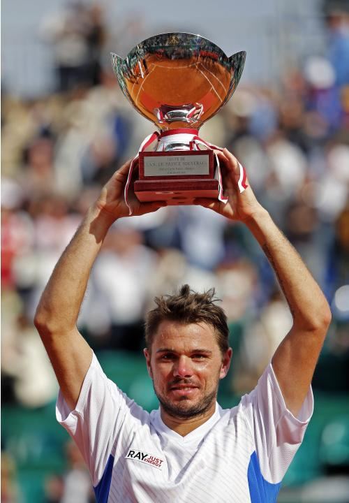 Wawrinka holds up his trophy after winning the final match against his compatriot Federer at the Monte Carlo Masters in Monaco