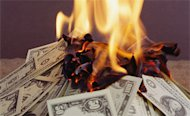 Traditional Advertising Versus Digital Advertising: Where Is Your Money Going? image burning through money