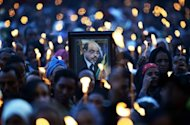 Mourners at a vigil for late Ethiopian Prime Minister Meles Zenawi in Addis Ababa in August. Ethiopia's new Prime Minister Hailemariam Desalegn took the oath of office Friday, vowing to maintain the legacy of long-time ruler Meles Zenawi who died last month