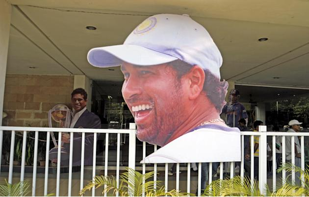 People watch a tableau on Sachin Tendulkar after its inaguration ahead of 199th test match of Sachin Tendulker at Eden Garden in Kolkata on Nov. 3, 2013. (Photo: IANS)