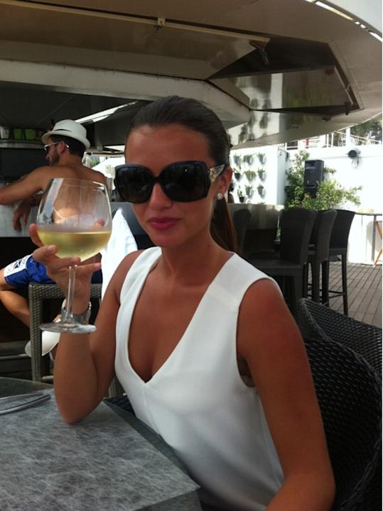 Celebrity photos: After celebrating her 21st birthday, TOWIE's Lucy Mecklenburgh was whisked off to Cannes by her fiancé Mario Falcone. She tweeted this picture of herself enjoying a drink in the sun