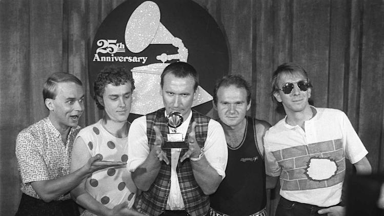 "FILE - In this Feb. 22, 1983 file photo, members of ""Men at Work,"" from left, Greg Ham, Ron Strykert, Colin Hay, Jerry Speiser and John Rees, pose with their Grammy for best new artist at the awards show in Los Angeles. Ham, a musician with the iconic Australian band Men at Work, was found dead in his Melbourne home on Thursday, April 19, 2012, Australian reports said. (AP Photo/File)"