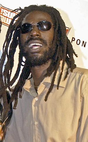 FILE - In this Oct. 13, 2003 file photo, Jamaican reggae star Buju Banton poses at the Source Hip-Hop Music Awards in Miami. A federal judge has denied reggae singer Buju Banton's request for a new trial, saying there's no need because of a previous appeals court ruling. A Florida jury found Grammy-winning reggae singer Buju Banton guilty on cocaine conspiracy on Feb. 22, 2011 after deliberating for 11 hours over two days. Banton is serving a 10-year prison sentence. (AP Photo/Yesikka Vivancos, File)
