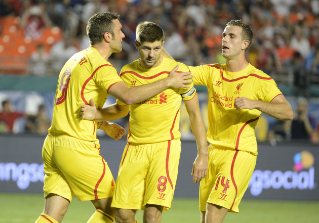 IMAGE DISTRIBUTED FOR GUINNESS INTERNATIONAL CHAMPIONS CUP - Liverpool's Steven Gerrard, center, celebrates with teammates, Rickie Lambert, left, and Jordan Henderson after he scored against Manchester United in the 2014 Guinness International Champions Cup Finals, on Monday, August 4, 2014 in Miami Gardens, FL. (Doug Murray/AP Images for Guinness International Champions Cup)