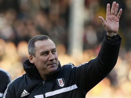 Fulham's head coach Meulensteen waves before their English Premier League soccer match against Swansea City in London