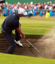 Adam Scott of Australia plays out of a bunker on the 18th fairway during his final round on day four of the 2012 British Open Golf Championship at Royal Lytham and St Annes in Lytham. Ernie Els won the championship with a score of 273, one shot clear of Adam Scott of Australia