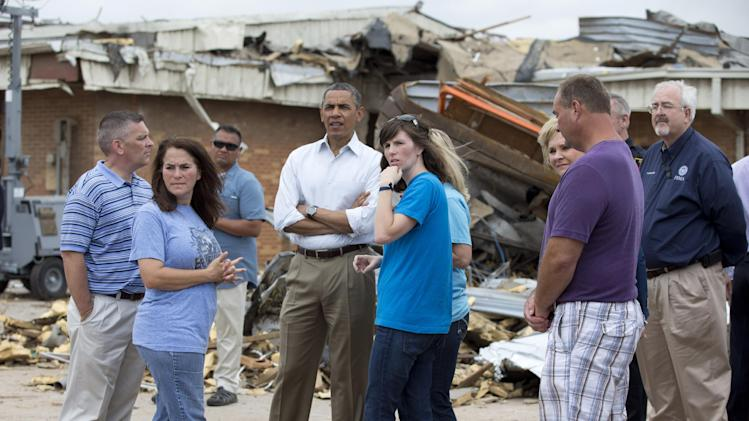 President Barack Obama and school officials view the destroyed Plaza Towers Elementary School, Sunday, May 26, 2013, in Moore, Okla., following the devastating tornado and severe weather last week. At the far right is FEMA administrator W. Craig Fugate. (AP Photo/Carolyn Kaster)