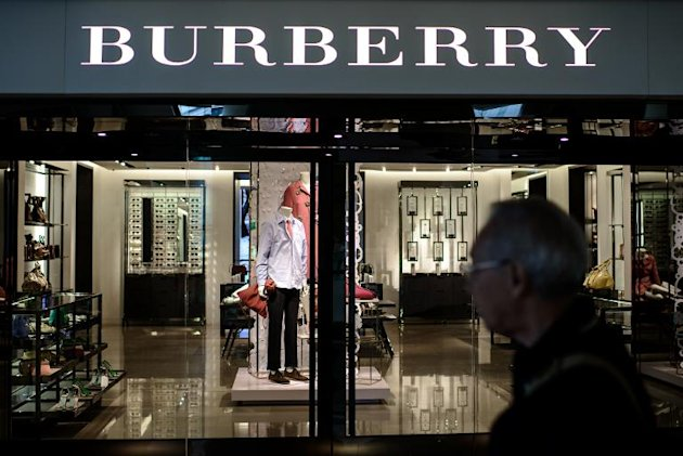 A man walks past a Burberry store in Hong Kong on February 21, 2014