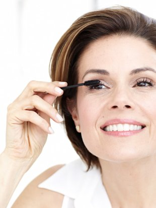 woman with mascara brush