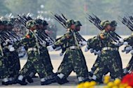 Myanmar's troops parade on March 27. Amnesty International accused Myanmar's military of committing crimes against humanity in ethnic conflict zones, where ongoing fighting has overshadowed sweeping political changes