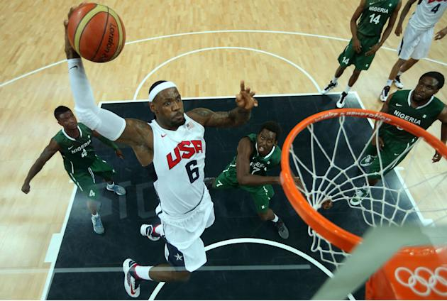 TOPSHOTS US Lebron James (C) shoots agai