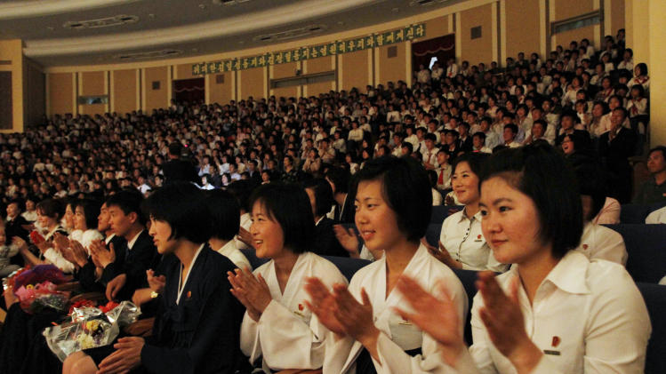 "North Koreans applaud during a performance of North Korean and Norwegian accordion players  in Pyongyang on Thursday May 17, 2012.  North Korean students shot to YouTube fame earlier this year with their spirited rendition of ""Take on Me."" They were joined Thursday by North Korean and Norwegian musicians for a concert in Pyongyang to mark Norway's national day. (AP Photo/Kim Kwang Hyon)"