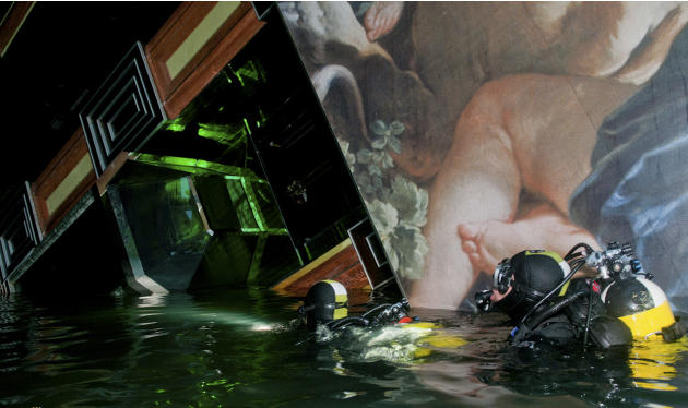 FILE  In this undated photo released by the Italian Navy Tuesday, Jan. 24, 2012, scuba divers inspect the Costa Concordia cruise ship grounded off the Tuscan island of Giglio, Italy. A veritable treas