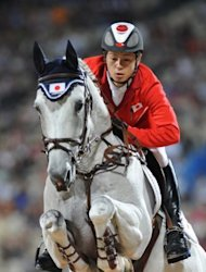 Eiken Sato, the younger brother of Kenki, rides Cayak during the Equestrian Jumping Individual competition at the 2008 Beijing Olympics in Hong Kong