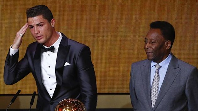 Portugal's Cristiano Ronaldo (L) gestures beside Pele after being awarded the FIFA Ballon d'Or 2013 in Zurich January 13, 2014.