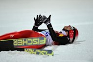 Simon Ammann lies on the snow after competing in the Men's Ski Jumping Normal Hill Individual Final Round at the RusSki Gorki Jumping Center on February 9, 2014 in Rosa Khutor