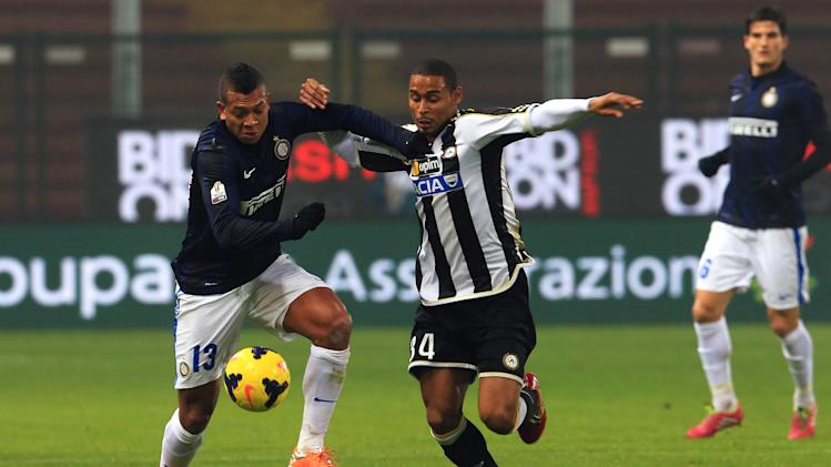 Inter Milan's Fredy Guarin, left, and Udinese's Antunes Da Silva go for the ball during an Italian Cup soccer match, between Udinese and Inter at the Friuli Stadium in Udine, Italy, Thursday, Jan. 9, 2014
