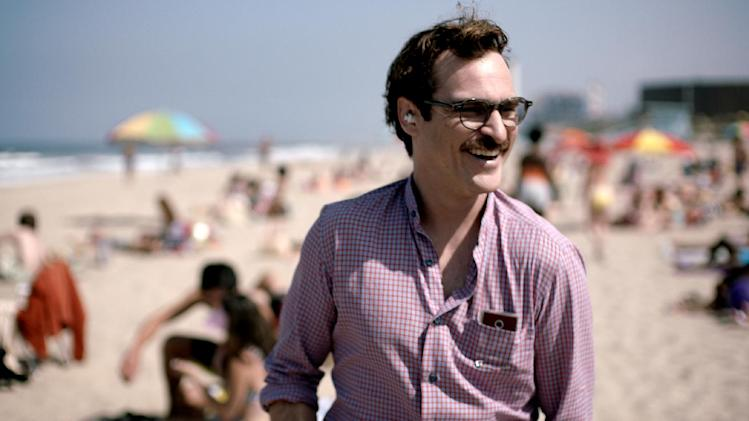 "FILE - This file image provided by Warner Bros. Pictures shows Joaquin Phoenix in a scene from ""Her."" In ""Her,"" Spike Jonze's futuristic exploration of a man's relationship with his computer, the filmmaker surveys human disjunction. (AP Photo/Warner Bros. Pictures, File)"
