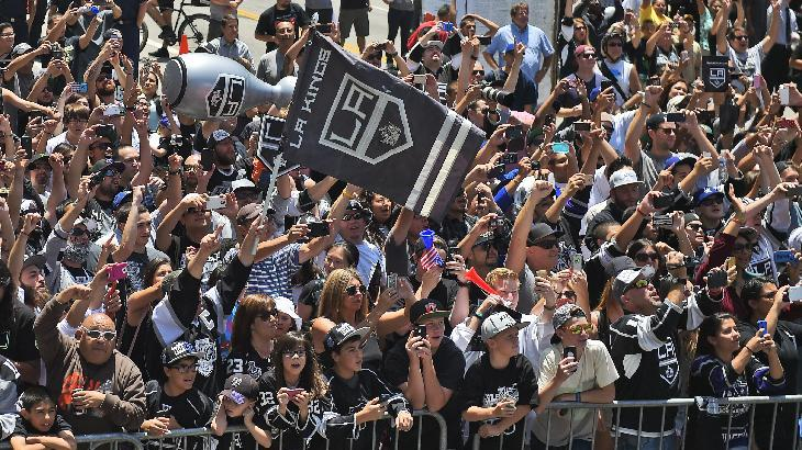 NHL hockey team cheer as the team rides by with the Stanley Cup trophy