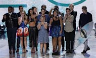 "The cast of television series ""Glee"" accepts the Choice TV Show: Comedy Award at the Teen Choice Awards at the Gibson amphitheatre in Universal City, California August 11, 2013. REUTERS/Mario Anzuoni/Files"