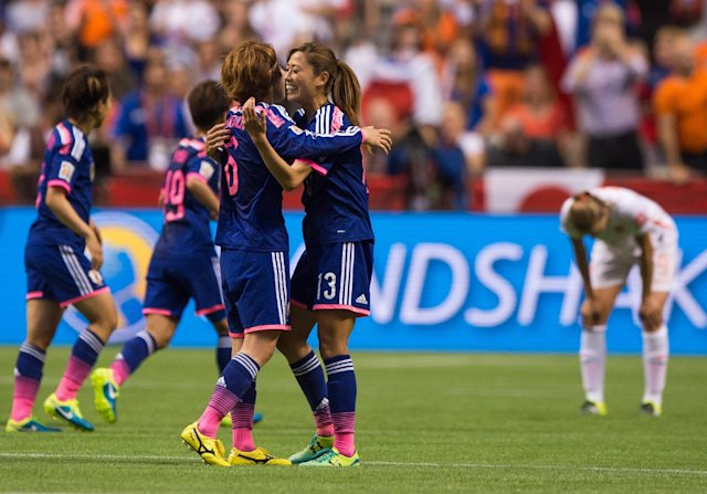 VANCOUVER, BC - JUNE 23: Mizuho Sakaguchi #6 and Rumi Utsugi #13 of Japan celebrate at the final whistle after defeating the Netherlands 2-1 during the FIFA Women's World Cup Canada 2015 Round of 16 match between the Netherlands and Japan June, 23, 2015 at BC Place Stadium in Vancouver, British Columbia, Canada.  (Photo by Rich Lam/Getty Images)