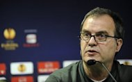 Athletic Bilbao's coach Marcelo Bielsa, pictured in April 2012, said Monday he is staying with the club despite earlier reports he was considering resigning in a row with the board